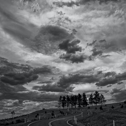 Threatening skies over Dairy Farmers Hill - National Arboretum of Australia