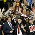 Trophy time - Louisville Cardinals head coach Rick Pitino hoists the trophy after defeating Michigan 82-76 in the NCAA Men's Basketball Championship at...