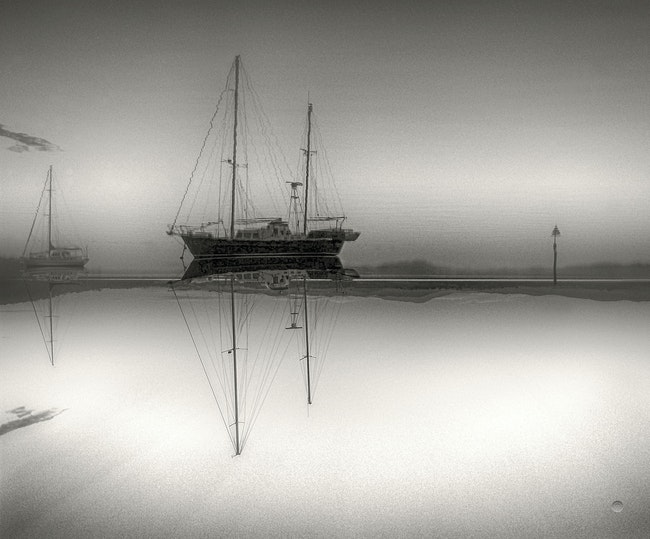 Illusion - Play on reflections.  Yachts at Beauty Point,Tasmania