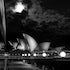 Opera House Moon & Park Hyatt - Black and white photograph taken in the window of The Park Hyatt ,Sydney,on a balmy night as the moon looms in the background.Long...