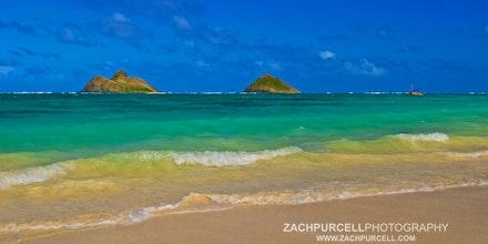 Lanikai Islands - Location: Lanikai Date: March 2011  Time: 1:30 PM ISO:125 Shutter Speed:1/80 sec. Aperture:13 Focal Length:24mm