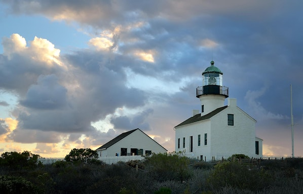 PointLomaLight-110912-15 - The Historic Point Loma Lighthouse after a storm with dramatic sky and sunset colors