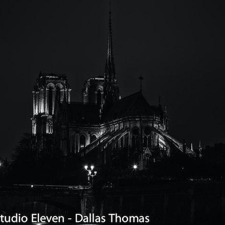 Parisian Street Scene - Notre Dame, Paris, France  on a gloomy night