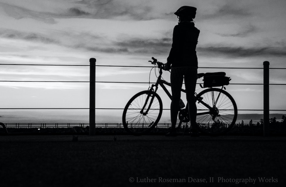 I dont mind being a Silhouette. - Said the lady, on the bike.