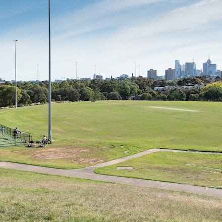 Clifton Hill - Ramsden Street Oval - City of Yarra Project - Cricket training at Ramsden Street Oval, Clifton Hill, with Melbourne city in the background