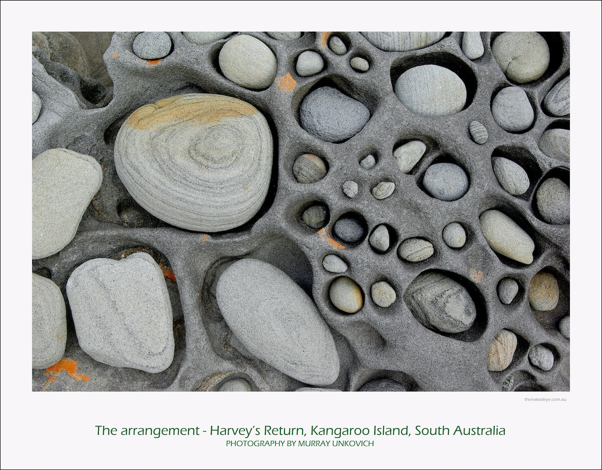 The arrangement - This is part of a large, unusual rock full of holes for which I spent about 2 hours finding stones just the right size and shape to fill....