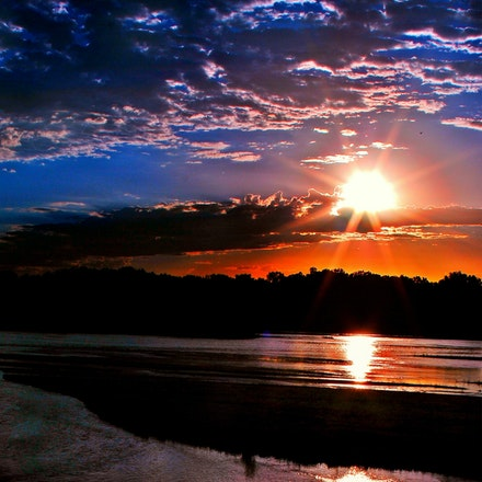 82214plattesunriseeastof GI (15) - An underexposed shot of the early morning sun over the Platte River.